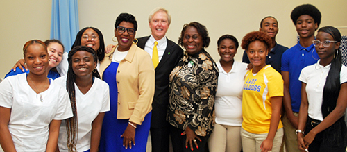 St. Joseph's/Candler President & CEO Paul P. Hinchey stand with a group of Beach High School students